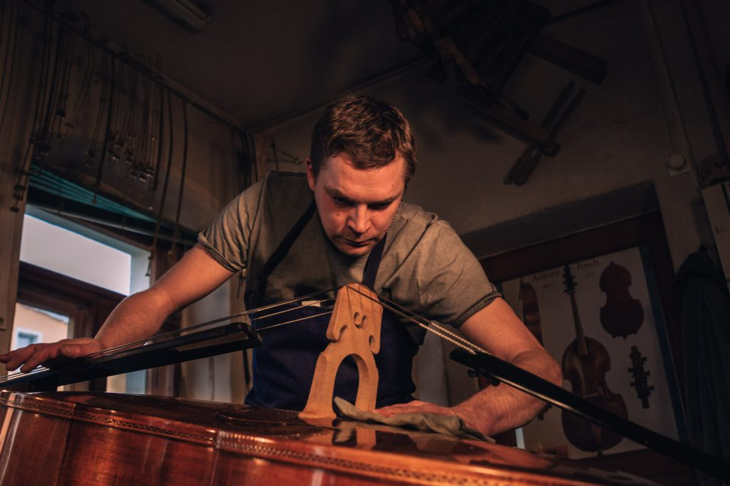 Marko Ackert polishes the double bass